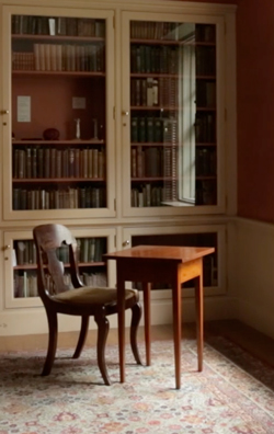 Emily Dickinson's writing table and chair, on display in the Houghton Library's Dickinson Room