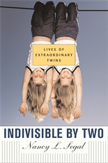 Cover: Indivisible by Two: Lives of  Extraordinary Twins
